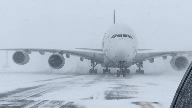 The world's largest passenger plane, a Singapore Airlines Airbus A380, was forced to land at Stewart International Airport on Thursday due to blizzard conditions.