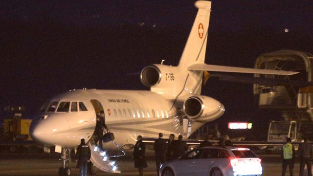 An unidentified man leaves a Dassault Falcon jet at an airport in Geneva, Switzerland.