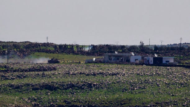 March 7, 2013: A Syrian Army tank moves towards the  Syrian village of Jamlah in the southern province of Daraa, Syria, as seen from the Israeli-controlled Golan Heights. Clashes between Syrian troops and rebel fighters flared on Thursday near an area where armed fighters linked to the opposition abducted 21 U.N. peacekeepers a day earlier. The peacekeepers are part of a force that monitors a cease-fire between Israeli and Syrian troops in the Golan Heights. Israel captured part of the territory in the 1967 Mideast war, and while the area has been peaceful for decades, Israeli officials have grown increasingly jittery as the Syrian civil war moves closer to its borders.