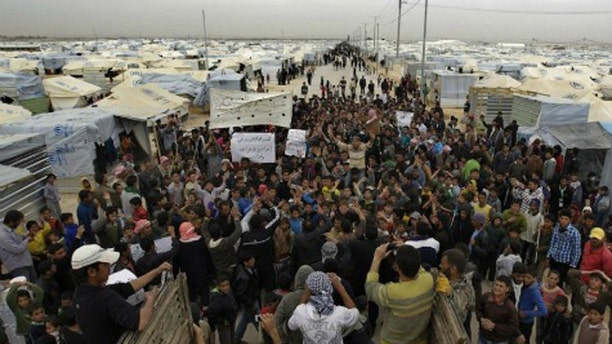 An estimated 500,000 Syrian refugees have fled to camps in Turkey. (AFP)