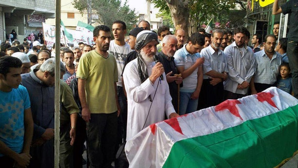 This citizen journalism image provided by Shaam News Network SNN, taken on Friday, Aug. 31, 2012, purports to show the funeral of Ahmed Ismail  Zaqzuq, killed in fighting with pro-government forces in Damascus, Syria.