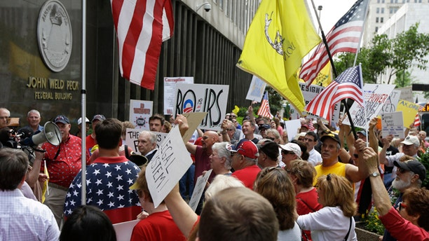 May 21, 2013: Tea Party activists demonstrate outside the John Weld Peck Federal Building in Cincinnati.