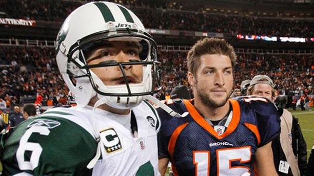 Nov. 17, 2011: In this file photo, New York Jets quarterback Mark Sanchez (6) and Denver Broncos quarterback Tim Tebow (15) walk off the field together after an NFL football game, in Denver.