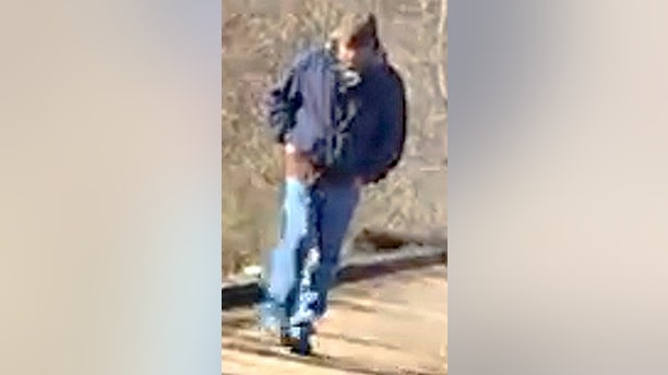 This Feb. 13, 2017, photo released by the Indiana State Police shows a man walking along the trail system in Delphi, Ind.