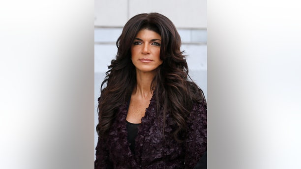 March 4, 2014.Teresa Giudice, 41, exits the Federal Court in Newark, New Jersey.