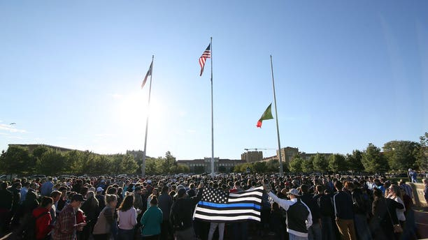 Supporters of Officer Floyd East Jr. at a memorial service Tuesday.