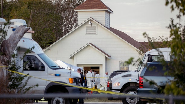 Investigators work at the scene of a deadly shooting at the First Baptist Church in Sutherland Springs.