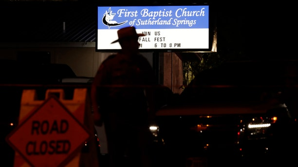 A law enforcement official stands watch outside the First Baptist Church of Sutherland Springs.