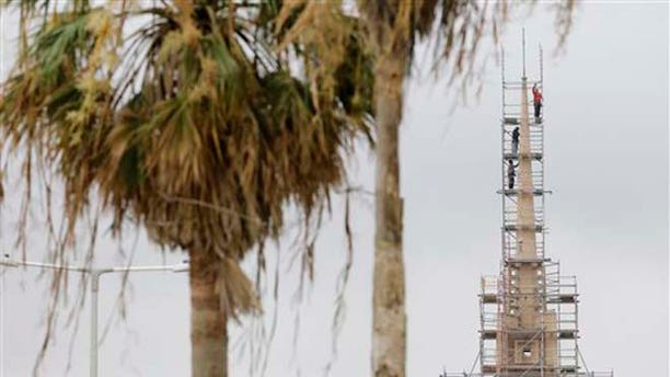 Workers secure scaffolding around First United Methodist Church, on the bay in Corpus Christi, Tuesday, June 16, 2015, as Tropical Storm Bill begins to make landfall. (AP Photo/Eric Gay)