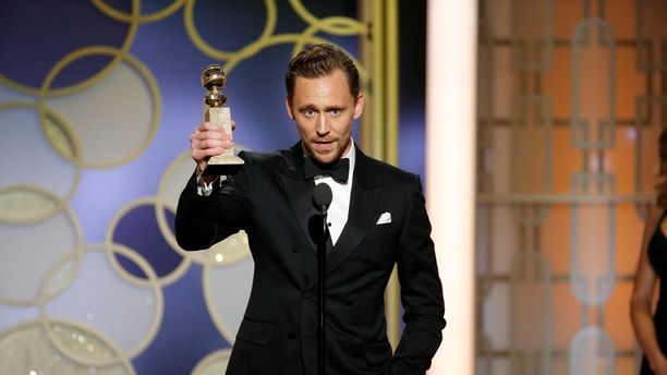 """This image released by NBC shows Tom Hiddleston with the award for best actor in a limited series or TV movie for """"The Night Manager,"""" at the 74th Annual Golden Globe Awards at the Beverly Hilton Hotel in Beverly Hills, Calif., on Sunday, Jan. 8, 2017."""