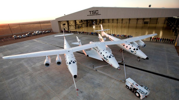 Sept. 19, 2011: More than 80 employees of The SpaceShip Company gather for a group photo at their new hangar facility, FAITH (final assembly integration test hangar), at the Mojave Air and Space Port in Mojave, CA.