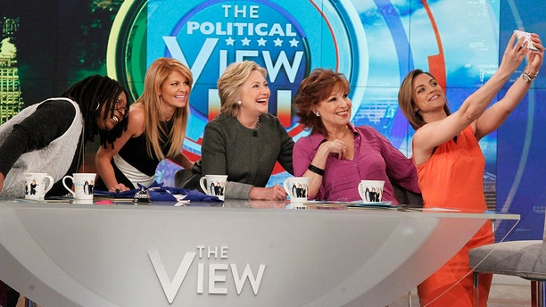 "Hillary Clinton, flanked by panelists in a 2016 appearance on ""The View."""