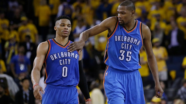 May 16, 2016:  Kevin Durant (35) pats Oklahoma City Thunder teammate Russell Westbrook (0) on the shoulder as they take a lead over the Golden State Warriors during the second half of Game 1 of the NBA Western Conference final.