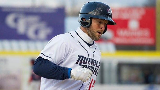 Tim Tebow, playing for the Binghamton Rumble Ponies, rounds third base after hitting a three-run home run in the first inning against the Portland Sea Dogs in a Double-A baseball game Thursday, April 5, 2018, in Binghamton, N.Y. (AP Photo/Matt Smith)