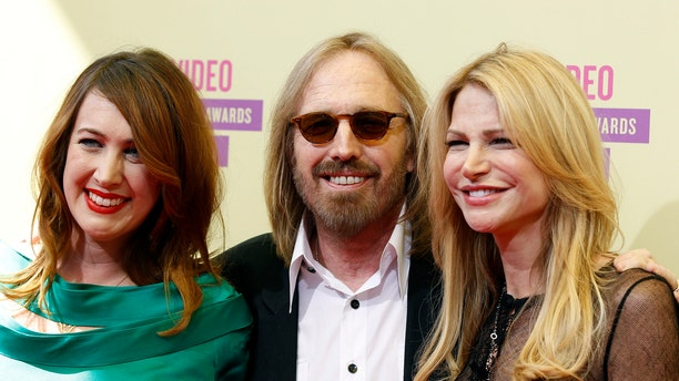 Tom Petty, wife wife Dana York (R) and daughter director Adria Petty arrive for the 2012 MTV Video Music Awards in Los Angeles, September 6, 2012.