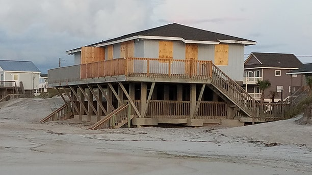 A home boarded up in preparation for Hurricane Florence in Topsail Beach, North Carolina, Wednesday
