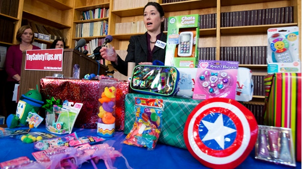 Nov. 26, 2013: Jenny Levin, of U.S. PIRG Public Health Advocate, speaks during a news conference in Washington, displaying a toy Captain America shield, right, together with others considered dangerous toys, according to U.S. PIRGs 28th annual Trouble in Toyland report.