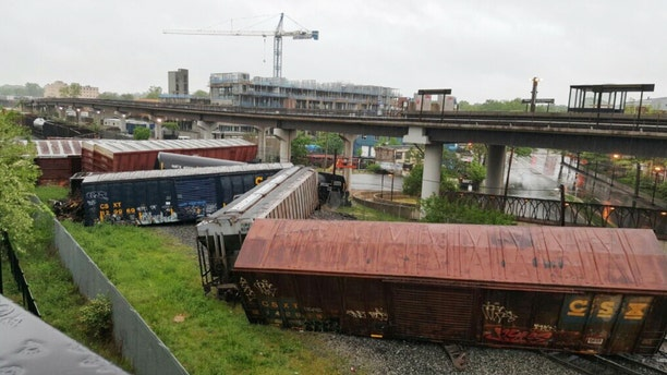 May 1, 2016: Several cars remain overturned after a CSX freight train derailed in Washington. (DC Fire and EMS via AP)
