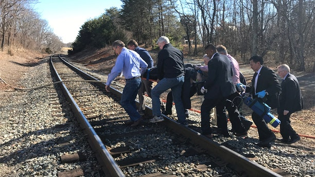 Lawmakers are seen carrying an injured victim after the train crash en route to the GOP retreat.