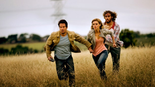 """Mark Wahlberg, as Cade Yeager, Nicola Peltz as Tessa Yeager, and T.J. Miller as Lucas Flannery, in """"Transformers: Age of Extinction."""""""