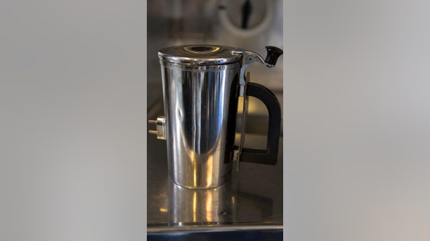 A hot cup sits on a counter inside a KC-10 Extender at Travis Air Force Base, Calif., in June.