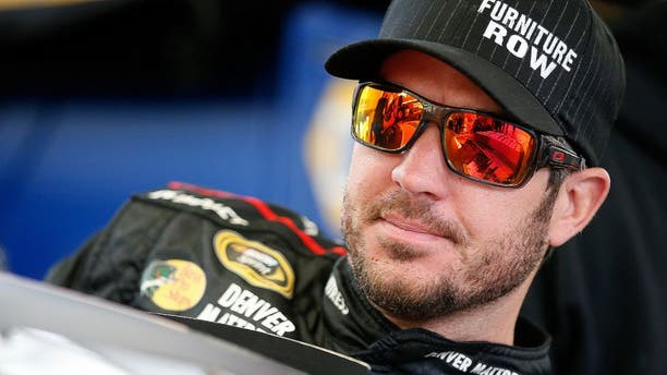 LAS VEGAS, NV - MARCH 05: Martin Truex Jr, driver of the #78 Furniture Row Toyota, steps into his car in the garage area during practice for the NASCAR Sprint Cup Series Kobalt 400 at Las Vegas Motor Speedway on March 5, 2016 in Las Vegas, Nevada. (Photo by Todd Warshaw/Getty Images)