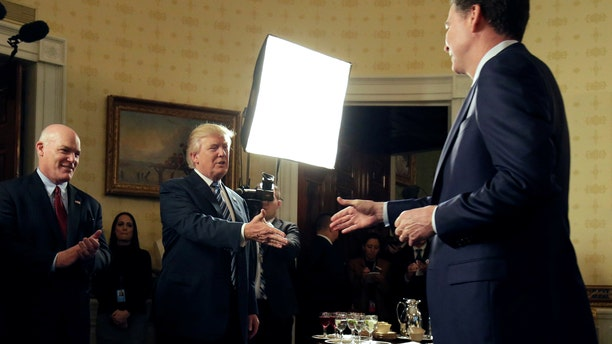 President Trump greets then-FBI Director James Comey at the White House on January 22, 2017.