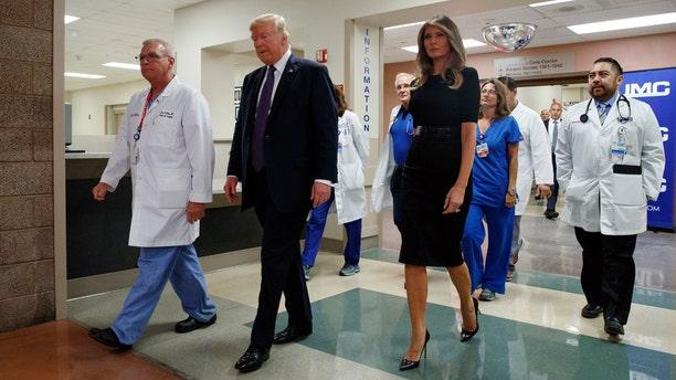 President Donald Trump and first lady Melania Trump visit a Las Vegas hospital, Oct. 4, 2017.