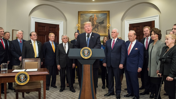 President Donald Trump speaks before signing the Presidential Space Directive - 1, directing NASA to return to the moon, in the Roosevelt room of the White House on Dec. 11, 2017.