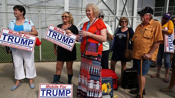 Aug. 21, 2015: Donald Trump supporters wait in line outside Ladd-Peebles Stadium hours before the start of a rally in Mobile, Ala.