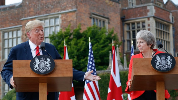 President Donald Trump with British Prime Minister Theresa May during their joint news conference at Chequers, in Buckinghamshire, England, Friday, July 13, 2018.