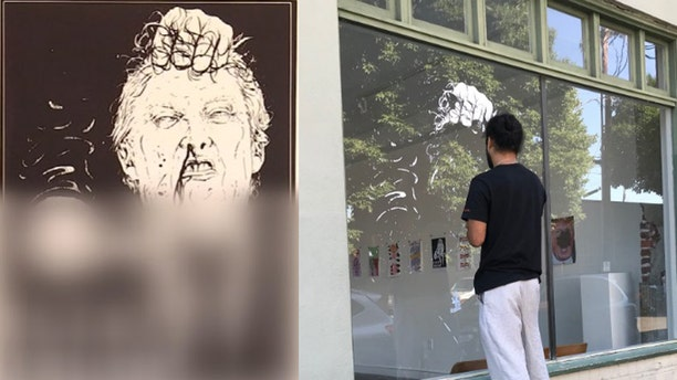 """The owner of the One Grand art gallery in Portland took down a graphic image depicting President Trump with a knife to his neck with """"F--- Trump"""" written under it."""