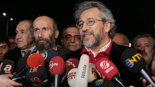 Feb. 26, 2016: Can Dundar, the editor-in-chief of opposition newspaper Cumhuriyet, right, and Erdem Gul, the paper's Ankara representative, front-left, speak to the media outside Silivri prison near Istanbul.