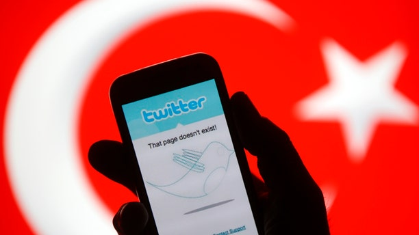 March 21, 2014: A person holds a Samsung Galaxy S4 displaying a Twitter error message in front of Turkish national flag in this illustration taken in Zenica.