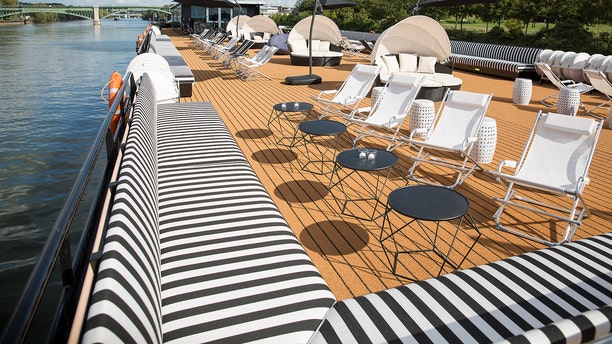 An upper deck lounge venue allows for sunbathing by day...