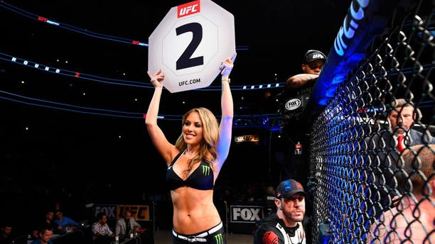 CHICAGO, IL - JULY 23: UFC Octagon Girl Brittney Palmer signals the start of round two between Michel Prazeres of Brazil and J.C. Cottrell in their lightweight bout during the UFC Fight Night event at the United Center on July 23, 2016 in Chicago, Illinois. (Photo by Josh Hedges/Zuffa LLC/Zuffa LLC via Getty Images)