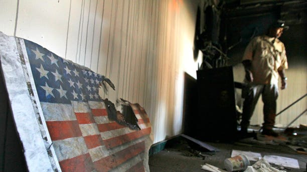 A US embassy broken flag during a visit for the press in the vandalized US Embassy in Tripoli, Libya, Monday, Sept. 12, 2011.