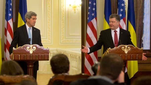 Feb. 5, 2015: Ukrainian President Petro Poroshenko, right, gestures toward U.S. Secretary of State John Kerry during their statement to the media at the Presidential Administration Building in Kiev, Ukraine.