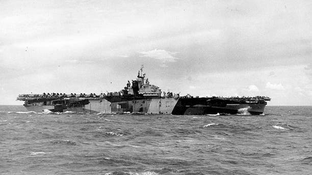 Aug. 1, 1944:The USS Franklin, pictured here painted in camouflage, was badly damaged in a Japanese attack in March 1945.