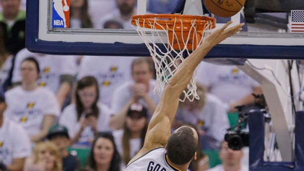 Utah Jazz center Rudy Gobert (27) goes for a rebound against the Los Angeles Clippers.