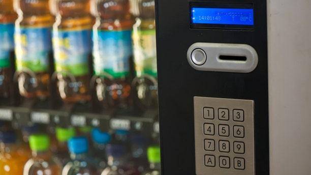 A vending machine provides various beverages