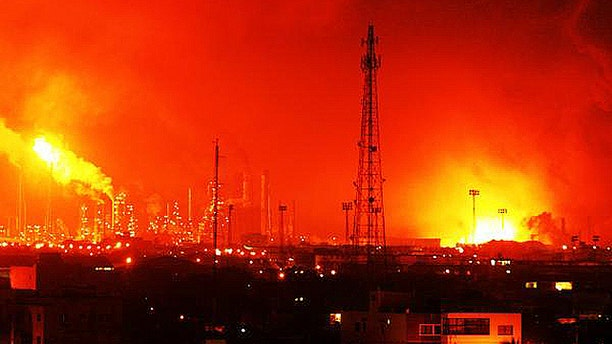 Aug. 25, 2012: Balls of fire rose over  Amuay refinery near Punto Fijo, Venezuela. A huge explosion rocked Venezuela's biggest oil refinery, killing at least 24 people and injuring dozens, an official said. (AP)