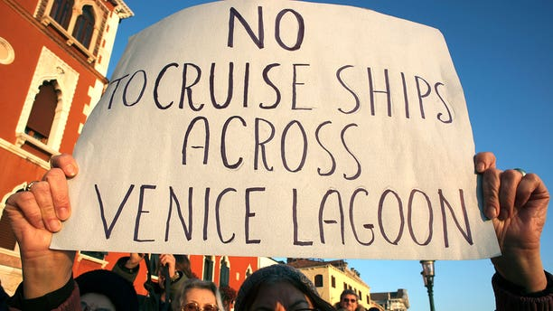 A person is seen protesting the transit of the cruises into the Venice lagoon back in 2012.