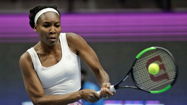 Venus Williams of the U.S. returns the ball to Kristina Mladenovic of France during the St. Petersburg Ladies Trophy-2017 tennis tournament match in St. Petersburg, Russia, Thursday, Feb. 2, 2017. (AP Photo/Dmitri Lovetsky)