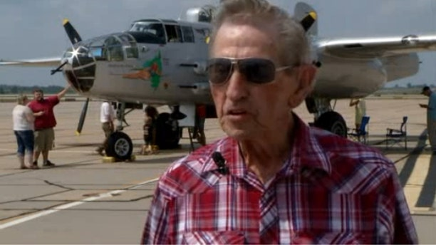 Marvin Russell, a Missouri World War II veteran, flew in a restored B-25 bomber Thursday, decades after he participated in missions in the same aircraft.