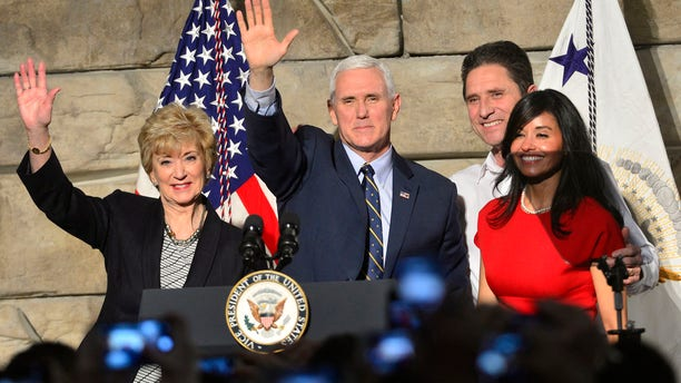 From left, SBA Administrator Linda McMahon, Vice President Mike Pence , Ronald Regan Foster, and Nancy Reagan Foster stand before a crowd on Saturday, March 25, 2017 in Charleston, W.Va.