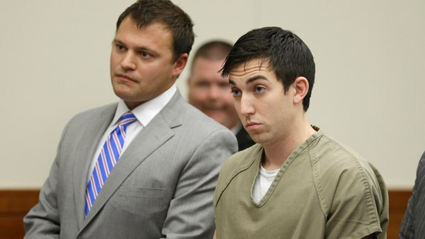 Oct. 23, 2013: Matthew Cordle, right, stands before a judge during sentencing in Columbus, Ohio.