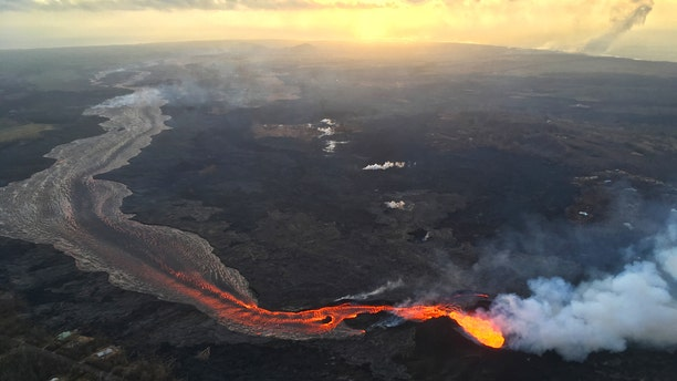 Sunrise above Kīlauea's lower East Rift Zone in Hawaii on July 17, 2018. The volcano's fissure 8 continues to feed a channelized lava flow that reaches the ocean.