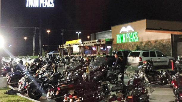 Police investigators search the scene at the Twin Peaks Restaurant in Waco, Texas.