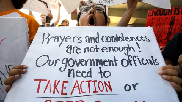 A student protester chants at a rally calling for more gun control three days after the shooting at Marjory Stoneman Douglas High School, in Fort Lauderdale, Florida, Feb. 17, 2018.